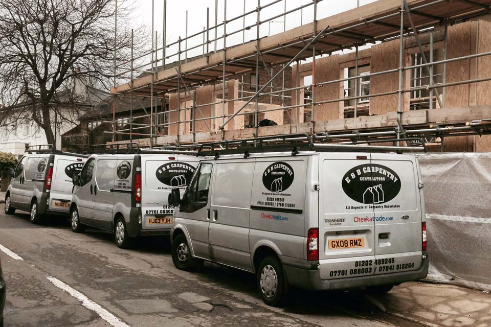 E&B Carpentry and Building Contractors - Vans at a building site